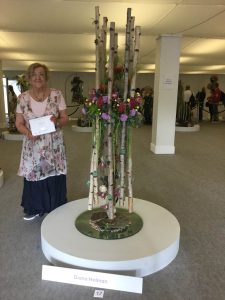 """Diana Holman with her exhibit  """"Beneath the Waves"""" which won a silver medal at the Chelsea Flower Show for Dorset & Guernsey Area. Photo courtesy of Caroline Jackson, NAFAS Press Officer."""
